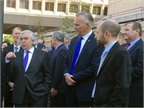 DOE Secretary Ernest Moniz, front left, with Volvo Trucks North