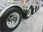 A lot of shiny wheels with automatic tire inflation on a bulk tanker.