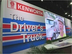 Kenworth s booth targeted drivers, highlighting its T680 in patriotic