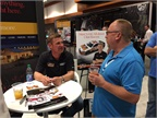 NASCAR driver Clint Bowyer signs autographs at the Rush Enterprises