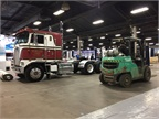 Crates, forklifts, rolled-up rugs ... all the signs of a truck show in
