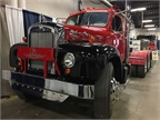 Antique trucks like this Mack are tucked away between booths in the