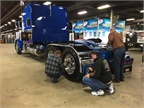 Putting a last-minute polish on a truck on display. Photo: Deborah