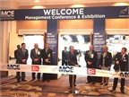 ATA Chairman Pat Thomas, center, opening the exhibit hall with a