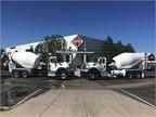 New mixer trucks displayed.