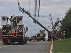 Utility crews work to restore power after Hurricane Sandy in New