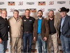 Rush and Clint Bowyer pose with trucking journalists, including HDT s