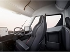 The cab features a center-mounted driver s seat, which Musk said gives