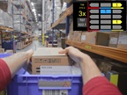 DHL pickers are equipped with advanced smart glasses, which visually display where each picked item needs to be placed on the cart. It enables hands-free order picking at a faster pace, along with reduced error rates. Photo: DHL