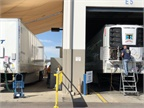 On the trailer side of SwiftTech, a technician looks at a Thermo King
