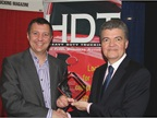 Heavy Duty Trucking Publisher David Moniz, right, presents Top 20