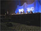 A panel discusses low-viscosity oils during a technical session at