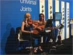 Live music at the Dana Spicer booth made exhibit hours more pleasant.