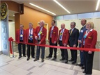 Outgoing TMC Chairman Kevin Tomlinson cuts the ceremonial ribbon opening the exhibit hall. Photo: Deborah Lockridge