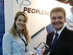 Emma Dahl, PeopleNet marketing specialist, accepts Top 20 award from