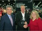John Walsh, Mack VP of marketing, center, accepts the Top 20 award