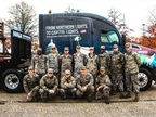 Soldiers at Joint Base Andrews pose with the U.S. Capitol Christmas