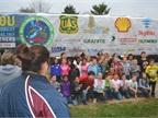 Children from Mt. Logan Elementary School gather to get their photo