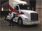 Fleet managers check out the Paccar SuperTruck at a  kick the tires