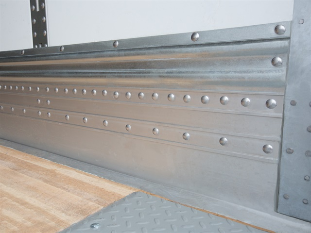 Moving the rivets away from the scrape zone keeps them out of harm's way from forklift loading.