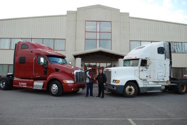 RoadOne driver, Martino Mendes, in front of his new eco-friendly GreenFleet truck (on left, burgundy) shakes hands with RoadOne's COO, David McLaughlin.