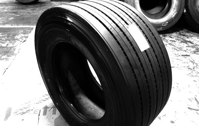 A truck tire just retreaded with Continental's HTL1 ContiTread flat precure tread sits freshly painted and ready for a fleet customer at DLS Retreading, Inc., a ContiTread licensed retreader in South Carolina.